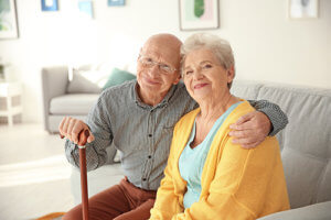 a couple is happy with senior living amenities