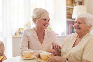 two women enjoy exclusive senior living programs in va